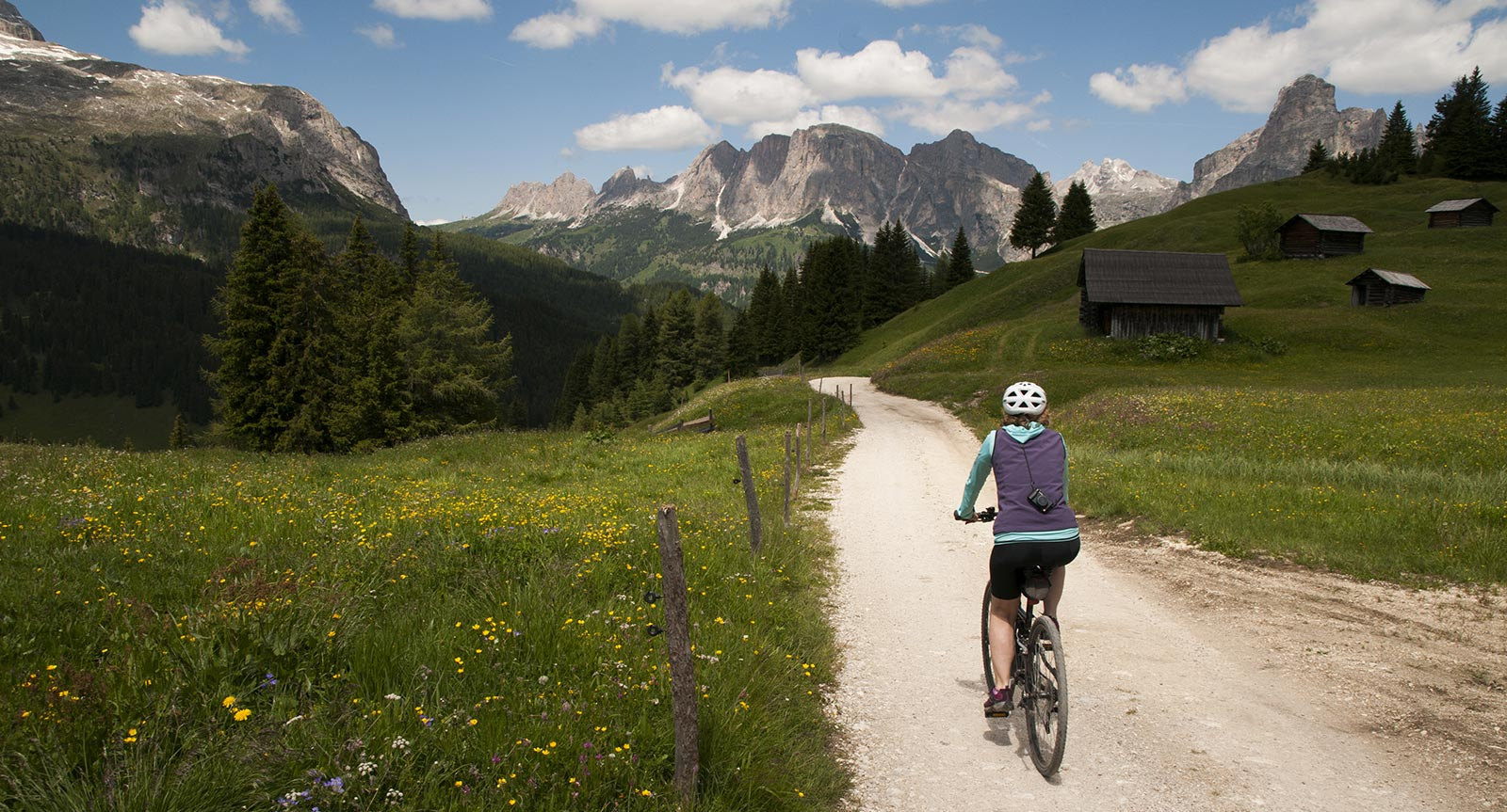 a mountain bike rider on a natural road in Alta Badia