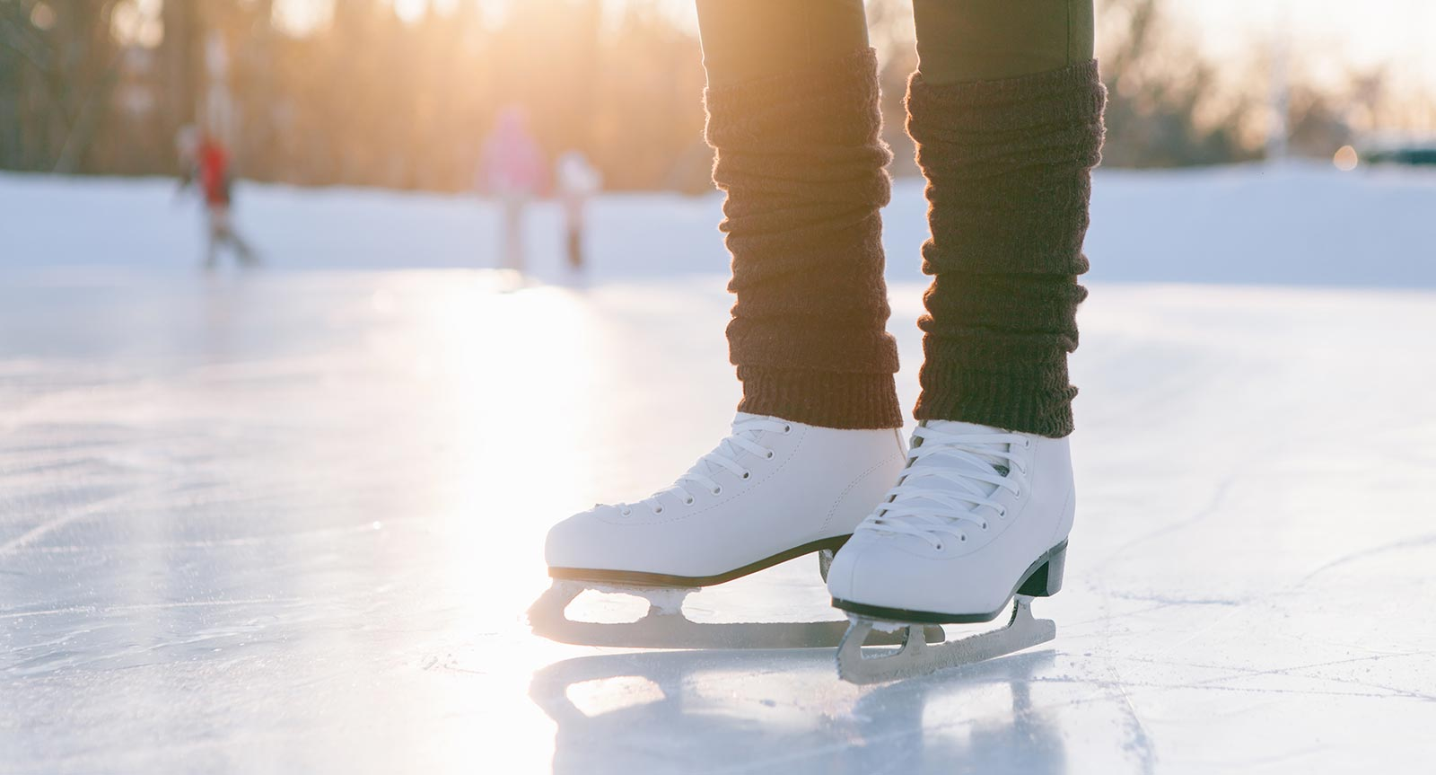 Close-up of a woman's skates on the ice